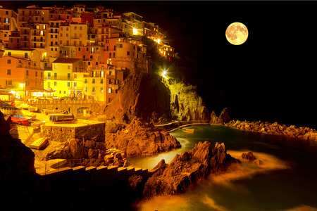 sea cliff: Moonlit night Manarola, top view, Italy Stock Photo
