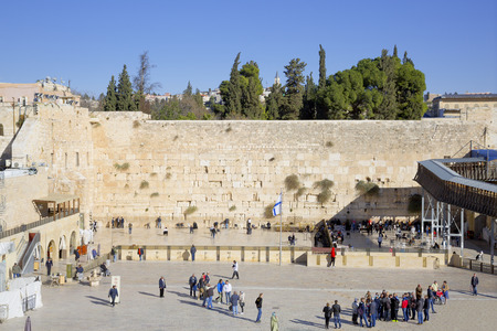 wailing: JERUSALEM, ISRAEL - DECEMBER 05, 2015: The faithful and tourists at the Wailing Wall in the Old City of Jerusalem, Israel