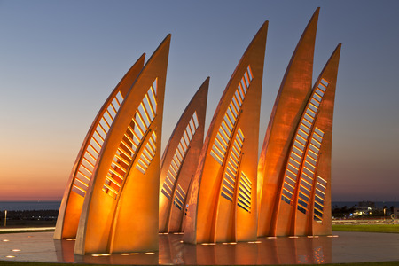 ASHDOD, ISRAEL - DECEMBER 08, 2015: Sculptural group sail with changing colors at sunset in Ashdod, Israel