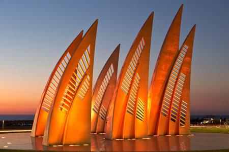 ashdod: ASHDOD, ISRAEL - DECEMBER 08, 2015: Sculptural group sail with changing colors at sunset in Ashdod, Israel