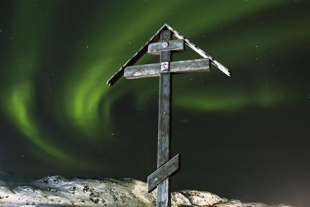 polar lights: Orthodox cross on a background of the polar lights on the top of the mountain, Russia