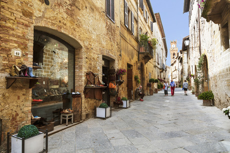 pienza: PIENZA, ITALY - AUGUST 03, 2015: Street in the medieval village of Pienza in Italy, Tuscany