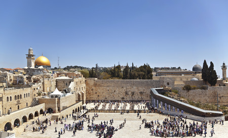 JERUSALEM, ISRAEL - APRIL 20,2012: Jewish worshipers pray at the Wailing Wall the greatest Shrine of Judaism Editorial