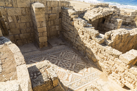 well known: The architecture of the Roman period in the national park Caesarea on the Mediterranean coast of Israel. Preserved fragment of Roman mosaics on the floor