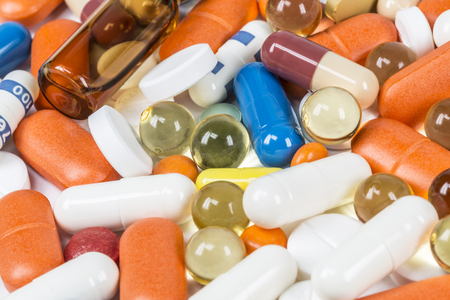 ampoules: Background of colorful tablets, capsules, ampoules closeup