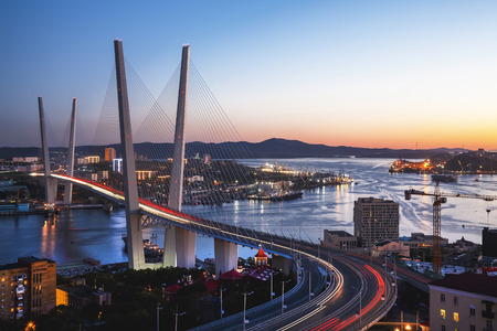 Panorama of Vladivostok at sunset, Far East Russia. Golden bridge. Editöryel