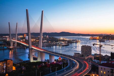 Panorama of Vladivostok at sunset, Far East Russia. Golden bridge. Editorial