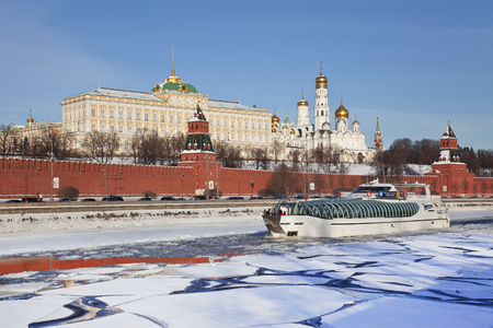moskva river: MOSCOW, RUSSIA - JANUARY 26, 2013: View of the Kremlin and the boat sailing along the Moskva river, Moscow, Russia