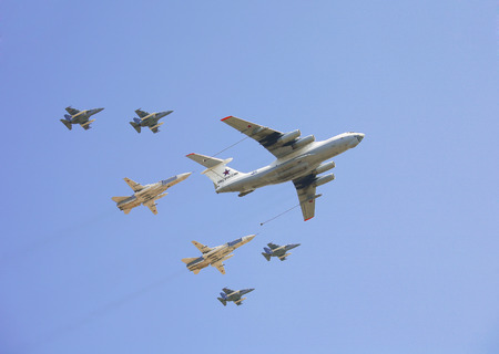 escorted: MOSCOW, RUSSIA - MAY 09, 2010: Plane-tanker Il-78 escorted by 2 bombers, Su-24 and 4 Yak-130 in the sky at the Victory Parade