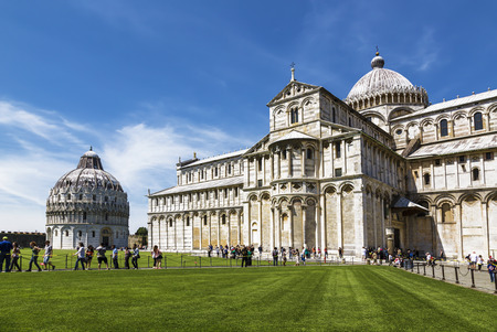 piazza dei miracoli: PISA, ITALY - MAY 10, 2014: Cathedral St. Mary of the Assumption and Baptistery of St. John in the Piazza dei Miracoli in Pisa, Italy Editorial