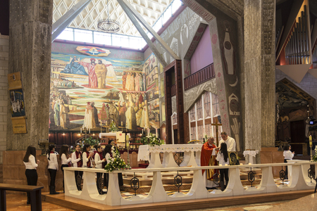 nazareth: NAZARETH, ISRAEL - DECEMBER 06, 2015: Church communion in the Church of the Annunciation in Nazareth, Israel Editorial