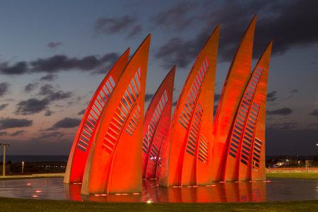 ashdod: ASHDOD, ISRAEL - DECEMBER 03, 2015: Sculptural group sail with changing colors at sunset in Ashdod, Israel