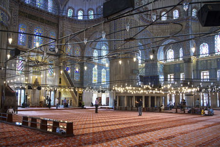 believers: ISTANBUL, TURKEY - MAY 16, 2015: Internal view of Blue Mosque and believers, Sultanahmet, Istanbul, Turkey Editorial