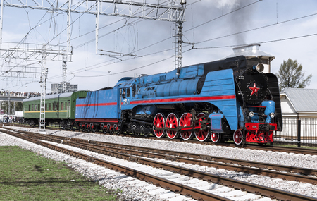 MOSCOW, RUSSIA - AUGUST 06, 2016: Demonstration of restored vintage locomotives in Moscow. The locomotive series P36 0027 rides