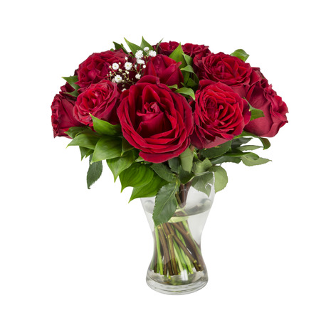 Beautiful red roses in a vase on a white background