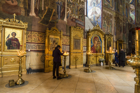 SERGIEV POSAD, RUSSIA 0 SEPTEMBER 26, 2016: Believers in the assumption Cathedral of the Trinity-Sergius Lavra, Sergiev Posad, Russia