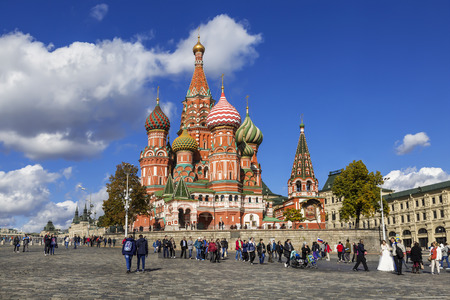 Tourists near Cathedral of Vasily the blessed on The Red square at sunny autumn day. Moscow, Russia Editorial