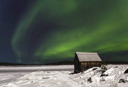 Northern lights over the Bay of the White sea near the village Nilmoguba, Karelia, Russia