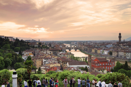 old photograph: FLORENCE, ITALY - MAY 8, 2014: Panorama of Florence at sunset. Tourists enjoy the view of Florence from the observation deck