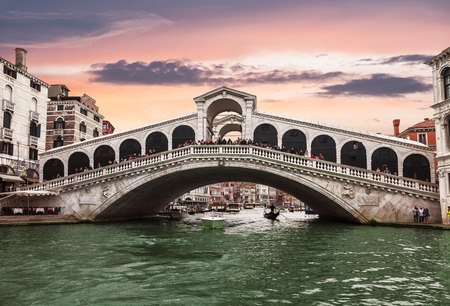 Views of the Grand canal and Rialto bridge at sunset. Venice, Italy