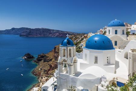 Blue domed churches in the village of Oia, Santorini (Thira), Cyclades Islands, Aegean Sea, Greece