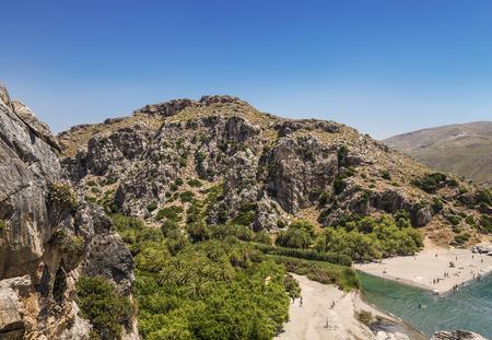 Top view of Preveli beach and river Megalo Potamos (Megalopotamo) in the place where it flows into the Libyan sea, Crete, Greece
