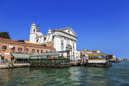 View of the church of Gesuati or Santa Maria del Rosario from the Grand Canal, the cafe and the vaporetto stop Zattere. Venice. Italy  Stock Photo