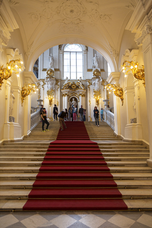 ST PETERSBURG, RUSSIA - JULY 11, 2015: Winter Palace. Tourists in the interior of the main parad Jordanian staircase