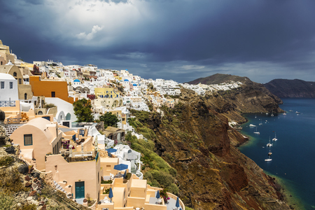 View of the city of Oia on the island of Santorini and the waters of the Aegean Sea in Greece Stock Photo