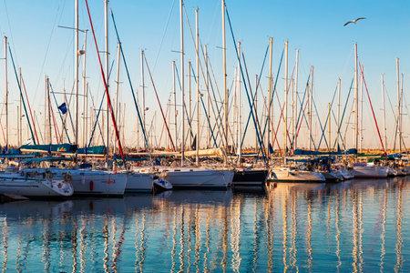Marina with docked yachts at sunset. Ashdod, Israel