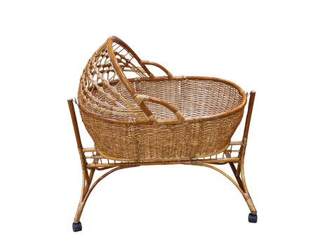 wooden cradle for kids from willow branches on white background isolated