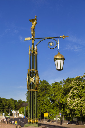 Vintage lamp on Panteleymonovsky bridge across the Fontanka river, Saint Petersburg, Russia