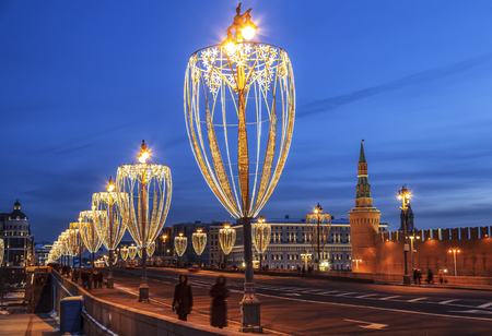 View of the Bolshoi Moskvoretsky bridge during the new year holidays in the evening, Moscow, Russia