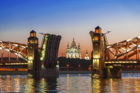 The central part of the divorced Bolsheokhtinsky bridge on the Neva river overlooking the Smolny Cathedral during the white nights. Saint Petersburg, Russia