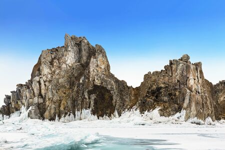 View of Shamanka rock on a sunny winter day. Lake Baikal, Olkhon island. Eastern Siberia, Russia Stok Fotoğraf - 130811488