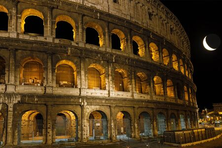 The Colosseum at moon night. Rome. Italy