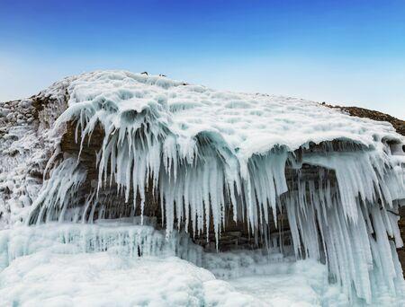 Fabulous ice icicles on the rocks of lake Baikal. Eastern Siberia, Russia