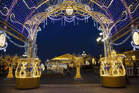 Manezhnaya square during New Year and Christmas holidays with glowing multi-colored arch, Moscow, Russia Editöryel