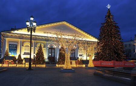 Manezhnaya square during New Year and Christmas holidays with glowing trees and decorated Christmas trees at night Editöryel