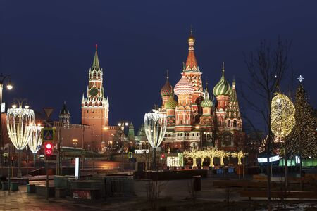 View of the Kremlin and Pokrovsky cathedral from Zaryadye park on christmas and new year holidays in the evening. Moscow, Russia