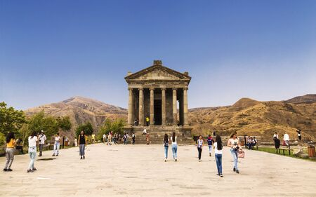 Tourists near the Garni Temple, a pagan temple in Armenia. It was built in the first century ad by the Armenian king Trdat