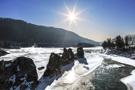 View of the Katun river with rocks called dragons teeth on a sunny winter day. Altai Republic, Russia Stok Fotoğraf