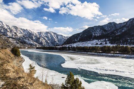Winter landscape, the Katun river flows among the Altai mountains. Altai Republic, Russia