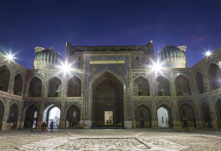 Inner court of the Sherdor madrasah on Registan square in Samarkand at night, Uzbekistan