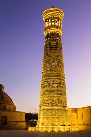 Kalyan minaret (12th century) at sunset in Bukhara, part of the architectural ensemble Poi-Kalyan, one of the oldest architectural monuments of the city. Uzbekistan
