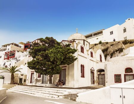 The view on Fira town and the Orthodox Church of St. John, Santorini, Greece Foto de archivo