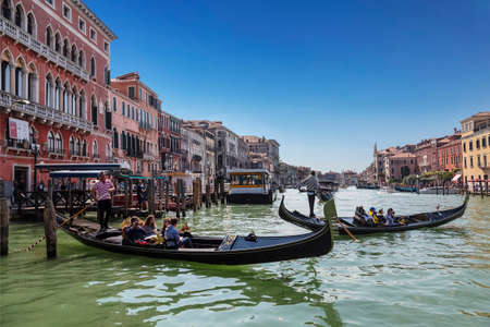 The Grand canal and gondolas with tourists, Venice, Italy