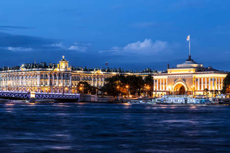 Night view of the Admiralty building, the Palace bridge and the Hermitage building. Saint Petersburg, Russia