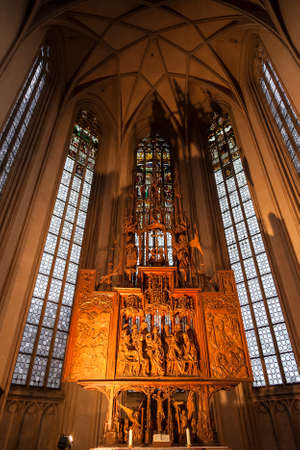 Interior of St. James Church in Rothenburg Ob der Tauber, wooden behind the altar the image of the