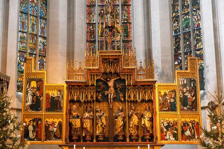 Interior of St. James Church in Rothenburg Ob der Tauber,  the altar. Bavaria, Germany